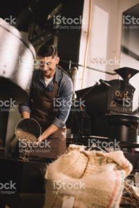 Normal man roasting coffee.
